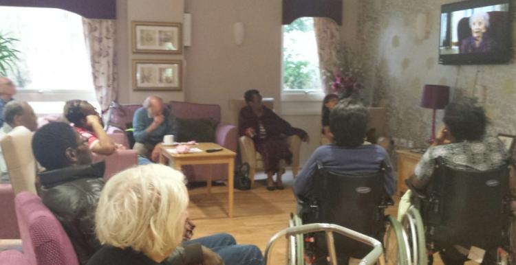 older people sitting in a care home