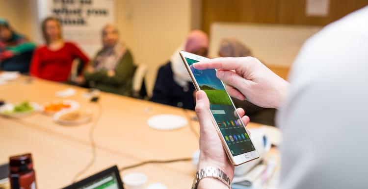 close up of a smartphone being used by someone in a meeting
