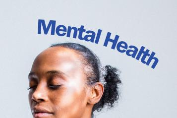 "a woman's has her eyes closed and has a serene expression on her face. The words ""Mental Health"" are hovering above her"