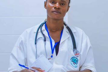 a black female doctor looking directly at the camera