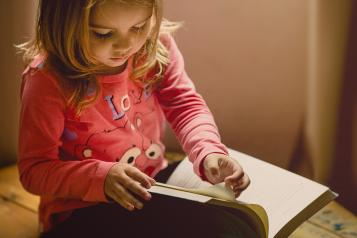 a child drawing in a book