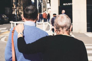 two people walking arm in arm