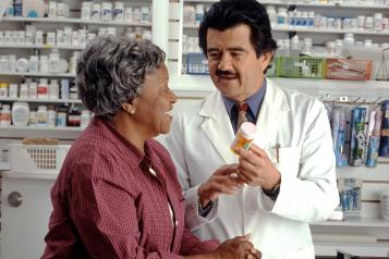 A lady speaking to the  pharmacist