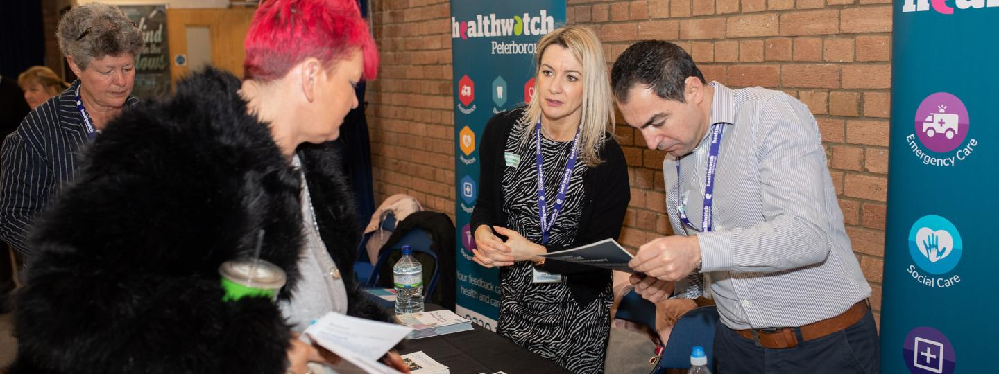 Four people standing at Healthwatch event