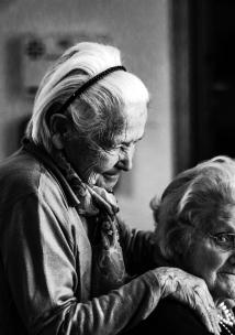 two old people caring for each other