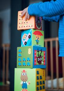 a child stacking cubes